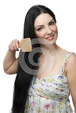Woman brushing her  long black hair