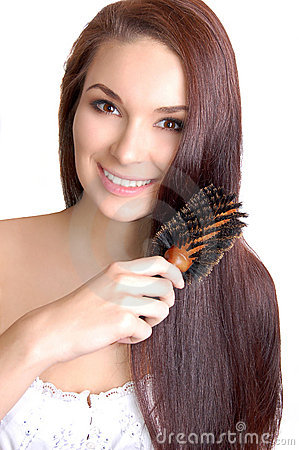 Woman brushing her long straight hair