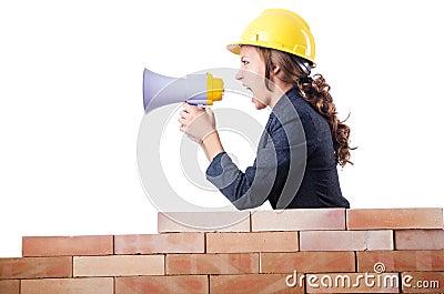 Woman builder with loudspeaker