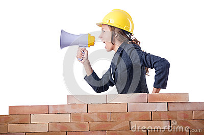 Woman builder with loudspeaker
