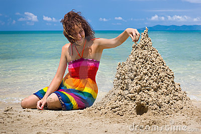 A woman building a sandcastle