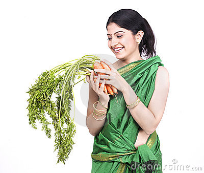Woman with a bunch of carrots