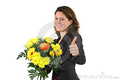 Woman with bunch of flowers posing with thumbs up