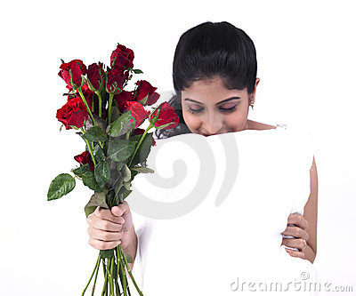 Woman with a bunch of red roses