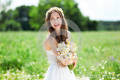 Woman with bunch of wildflowers