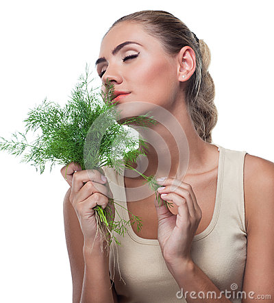 Woman with  bundle herbs (dill)