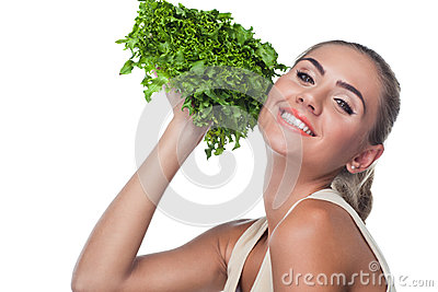 Woman with  bundle herbs (salat)
