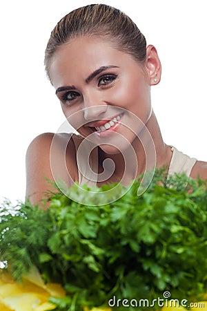 Woman with bundle herbs (salat)