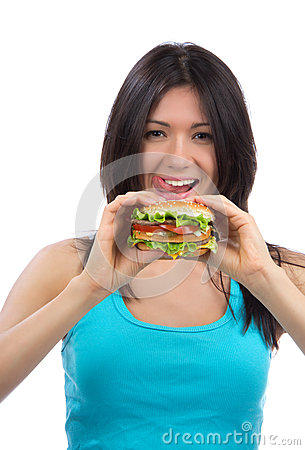 Woman with burger in hand hungry