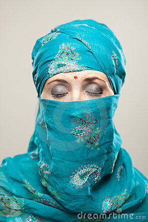 Woman in burqa with makeup