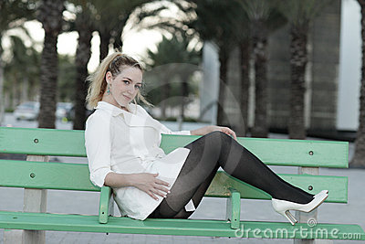 Woman on a bus bench