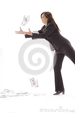 Woman in business suit catching money vertical