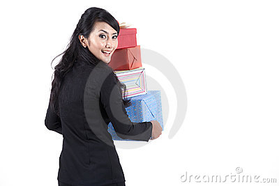 Woman in business suit with Christmas Gifts