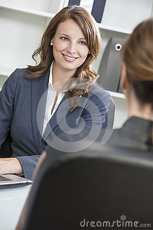Woman or Businesswoman in Office Meeting
