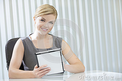 Woman Businesswoman on Tablet Computer in Office