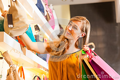 Woman Buying A Bag In Mall Stock Image - Image: 26487001