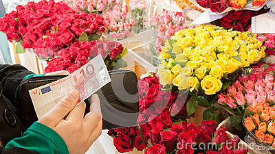 A woman buying flowers