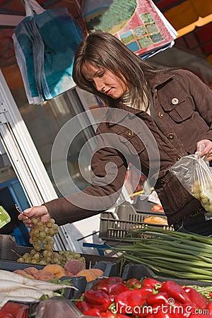 Woman buying grapes