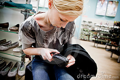 Woman buying shoes in a store