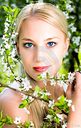 Free Woman By Flowers On Tree Stock Photos - 9389073