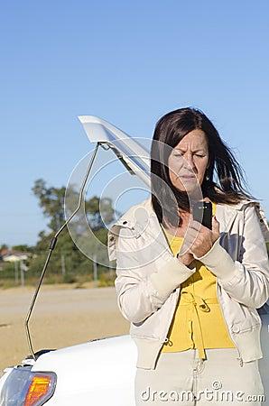 Woman calling help car breakdown