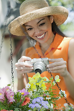 Woman with a camera in the Garden