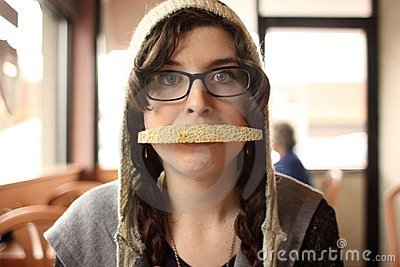 Woman with cantaloupe in mouth