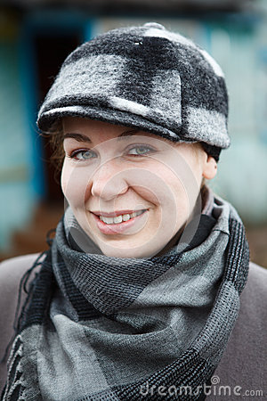 Woman with cap and scarf