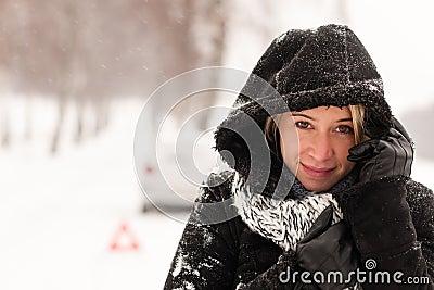Woman car breakdown snow accident winter road