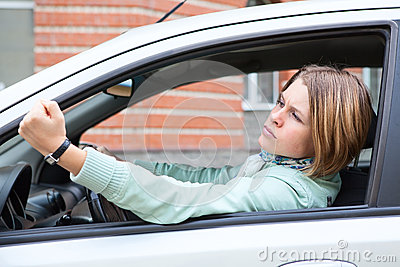 Woman in car making some bad gestures