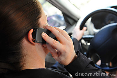 Woman in a car talking on a phone