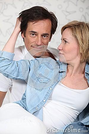 Woman caressing man s hair