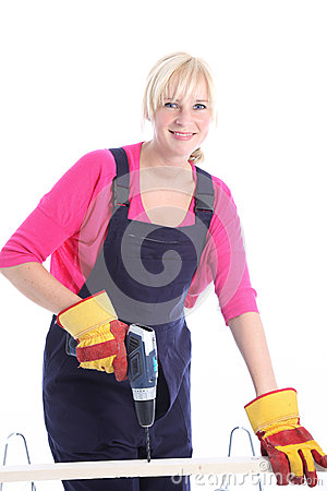 Woman carpenter using a power drill