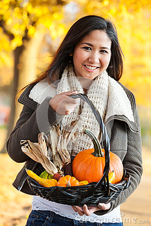 Woman carrying autumn harvest basket