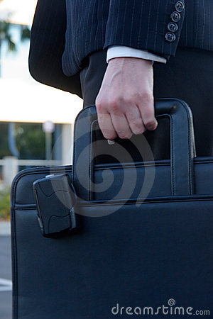 Woman carrying briefcase with pager