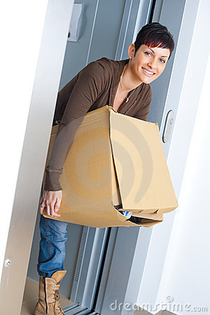 Woman carrying cardboard box