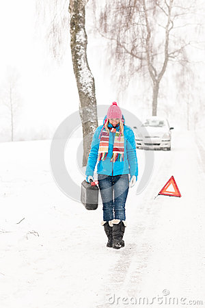 Woman carrying gas can snow car trouble