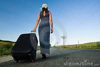 woman carrying a heavy bag