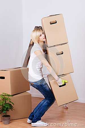 woman carrying heavy cardboard boxes in house royalty free stock photography image 31272967. Black Bedroom Furniture Sets. Home Design Ideas