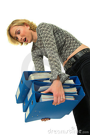 Woman carrying heavy files