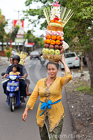 Woman carrying offerings Editorial Stock Photo