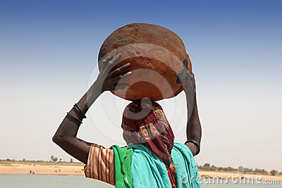 Woman carrying a pot Editorial Photography