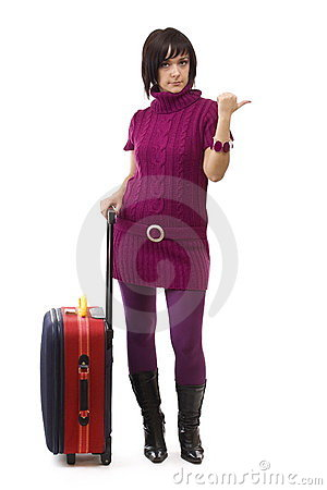 Woman carrying a suitcase and hitchhiking