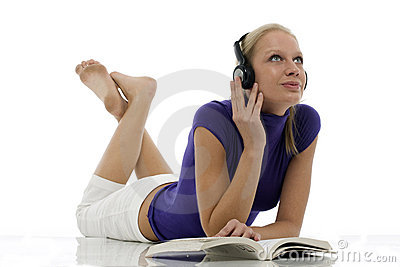 Woman with casual clothing with book and headphone