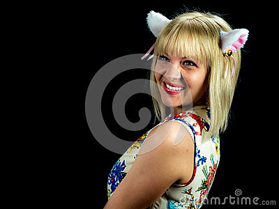Woman with cat ears. on black background Stock Photo