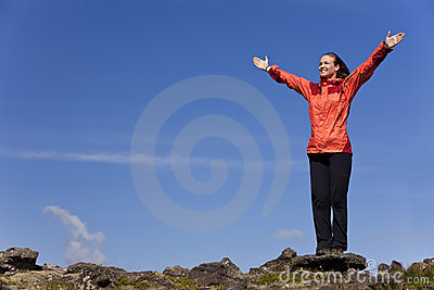 Woman Celebrating Achievement on Top Of A Mountain