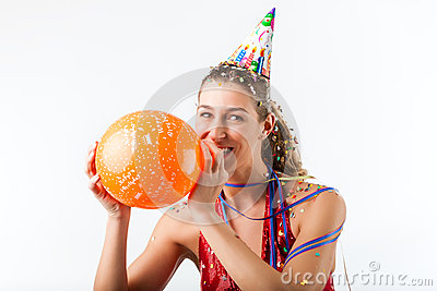 Woman celebrating birthday with balloon