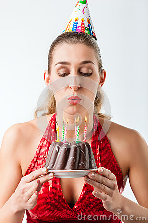 Free Woman Celebrating Birthday With Cake Blowing Candles Out Royalty Free Stock Image - 28438696