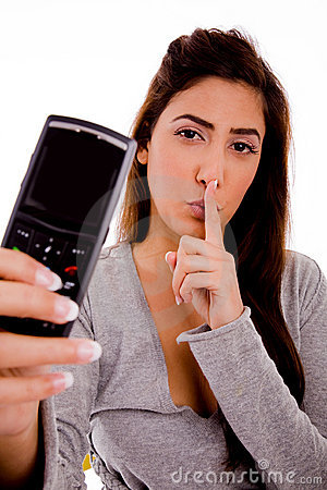 Woman with cell phone instructing to be silent