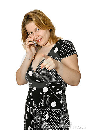Woman on cellphone with finger pointing at viewer